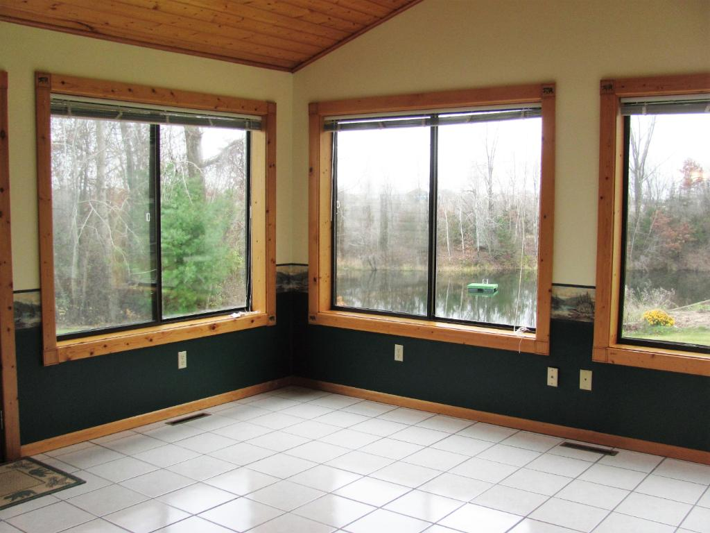spacious 3 season porch with spectacular lake views.