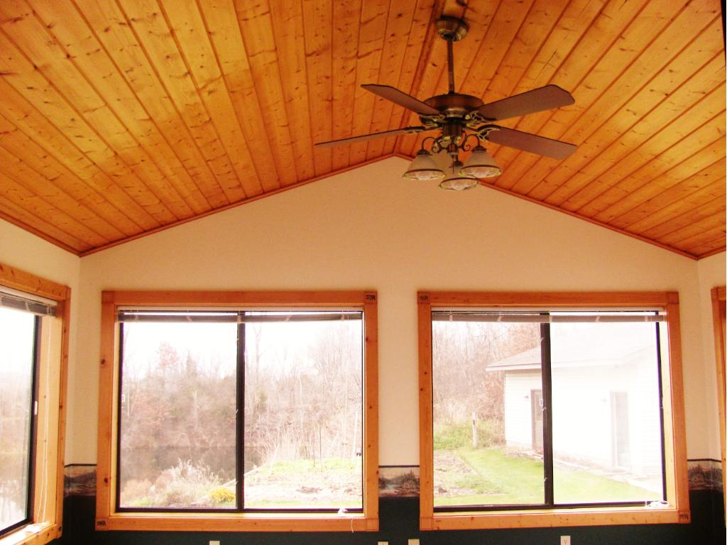 Vaulted knotty pine ceiling in the porch.