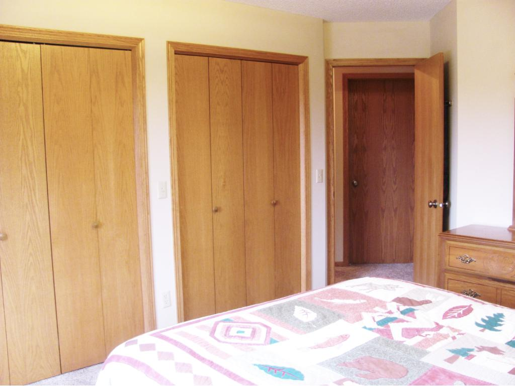 Another view of the master bedroom with double closets.