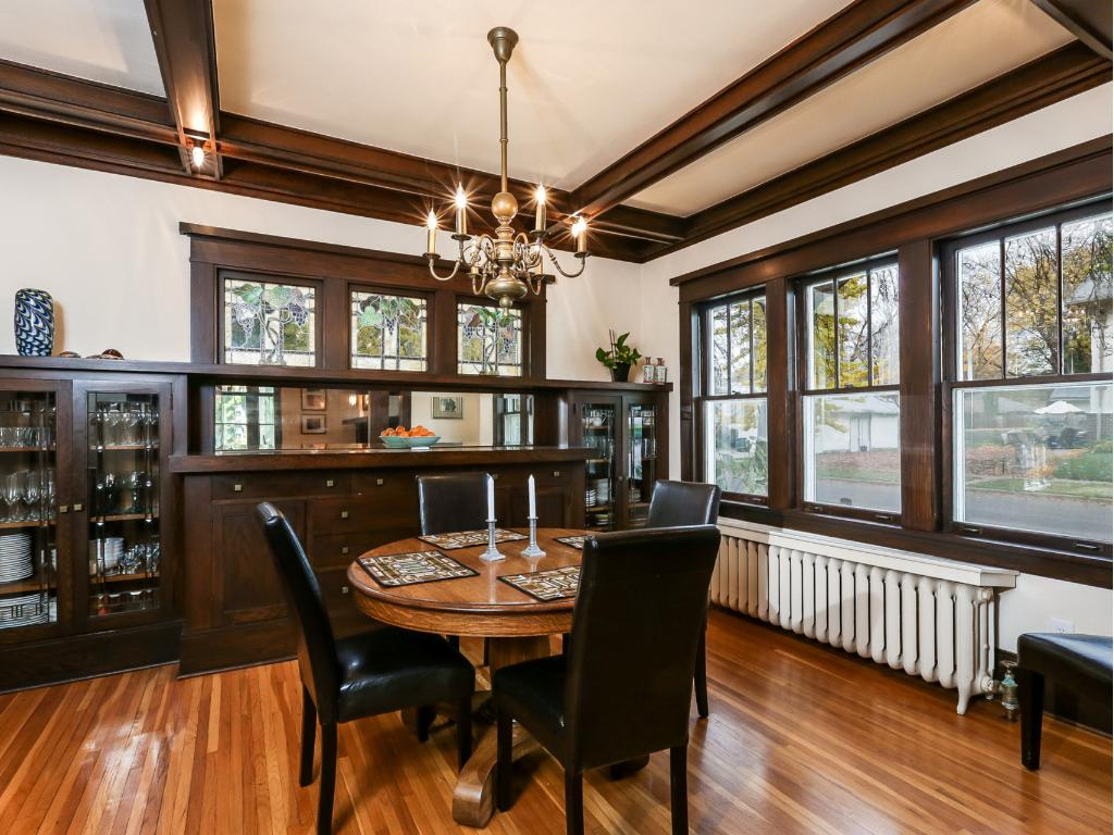 Dinner parties in this beautiful dining room will be long remembered. Notice box beamed ceilings, original chandelier, stained and leaded glass windows.