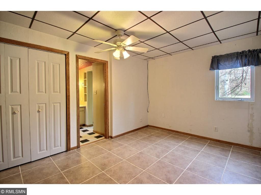 This main floor bedroom has tile floor and a road facing window.  You will enjoy the convenience or a private door accessing the 3/4 bathroom.