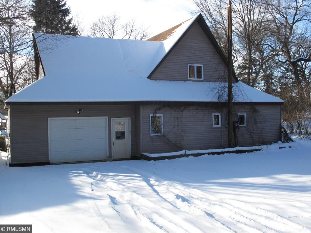 You will love the large 1 car attached garage, especially in snowy Minnesota winters!  Add shelving for additional storage. The garage does have a back service door for easy lake access.
