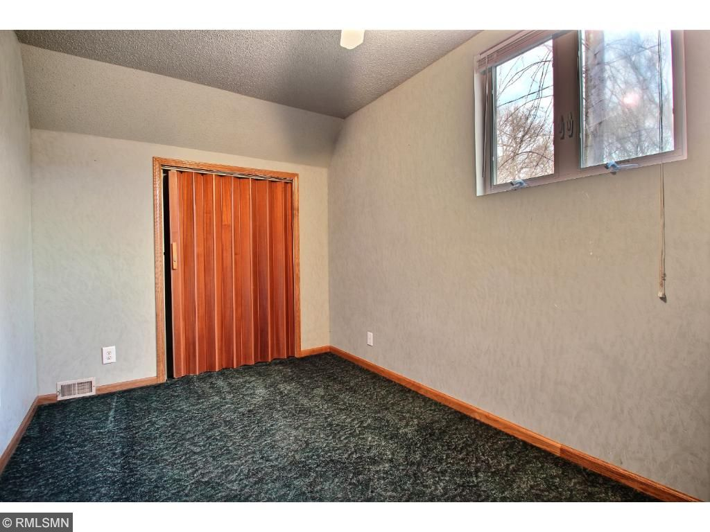 The upper level is home to 2 bedrooms.  This is the smaller one, great for kids, or a guest room.