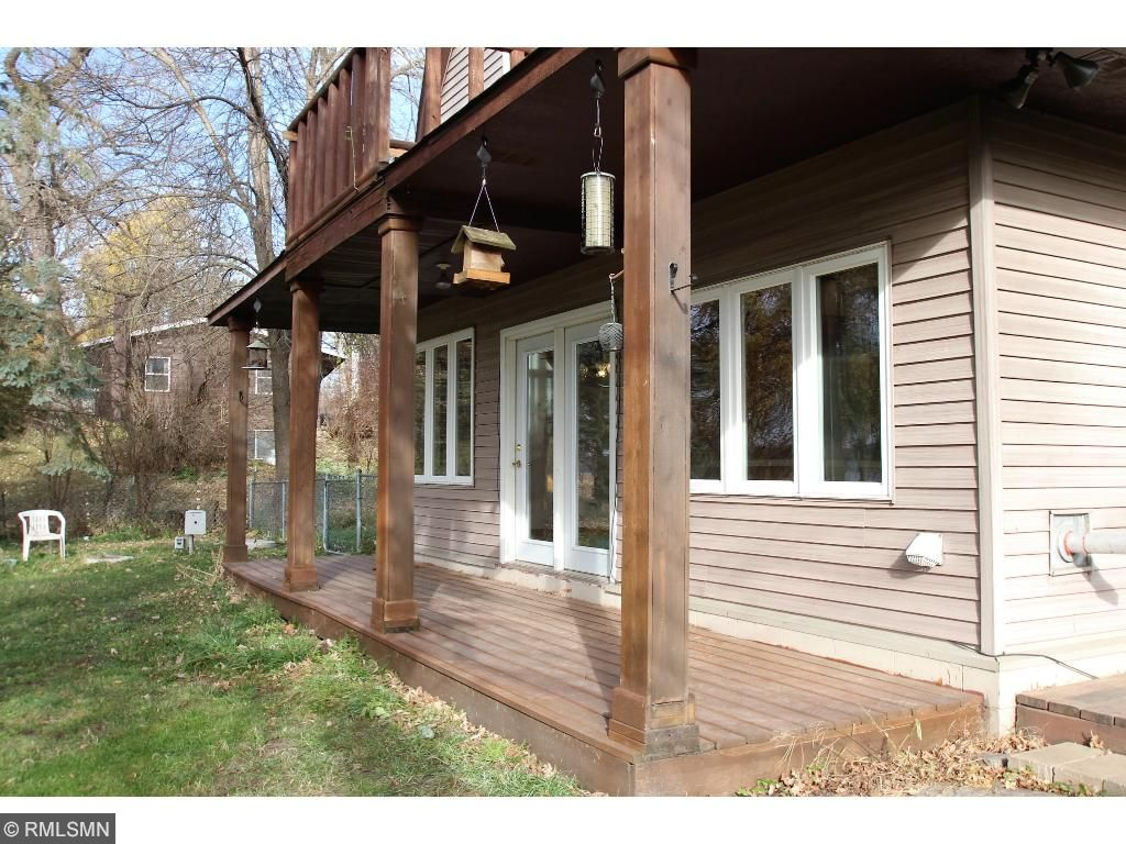 Who doesn't like a front porch, especially when the views from it are on the lake!  Add a few comfortable chairs and you are set.  The roof over hang will give you protection from the sun and rain.  The home is wrapped in wood toned vinyl siding.