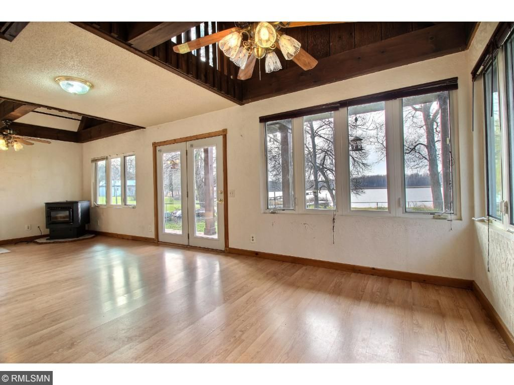 The main living area is surrounded with windows for lake views from all angles!  Laminate flooring is nice for wet and sandy feet after a day on the lake.