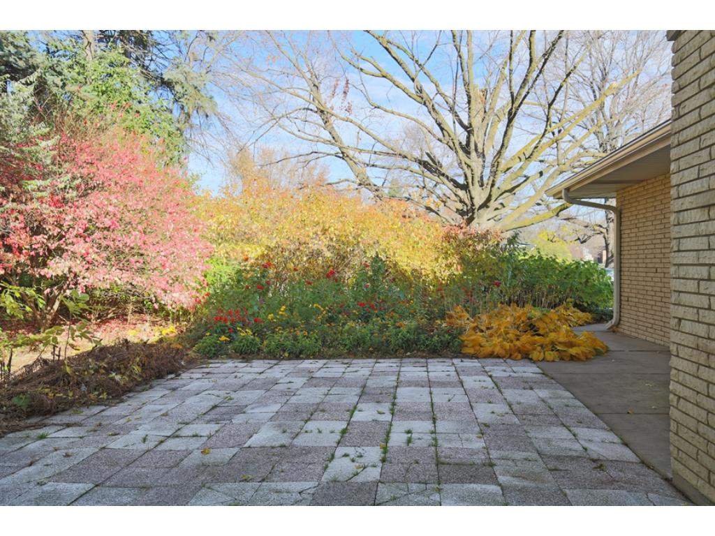 Gorgeous colors in the private back yard, with deck and patio