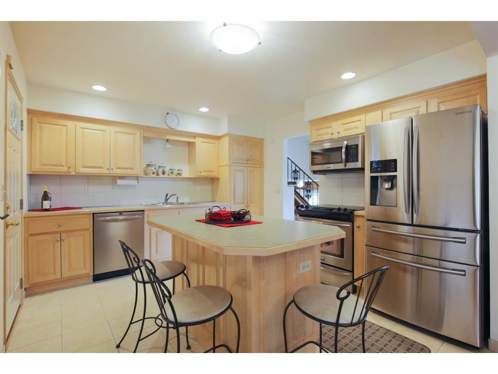 Beautifully updated kitchen with stainless appliances and island