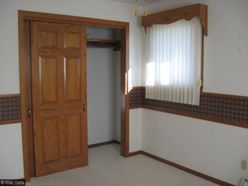 Master bedroom closet.  Note the oak six panel doors