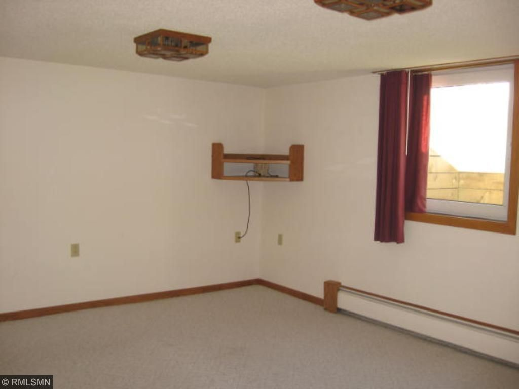 Lower level bedroom with walk in closet