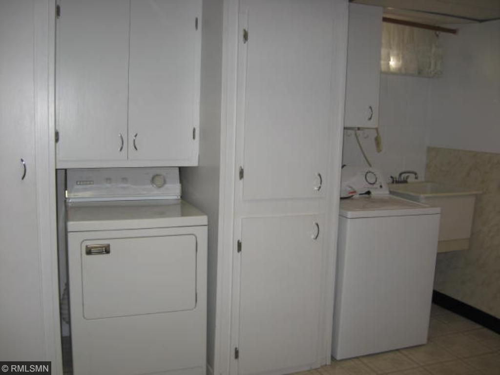 Laundry room area with additional storage