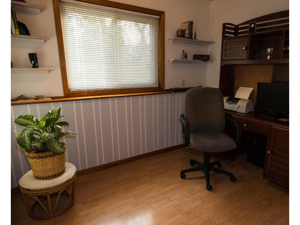 Office space just off the family room is large enough for two work stations and has great natural light.