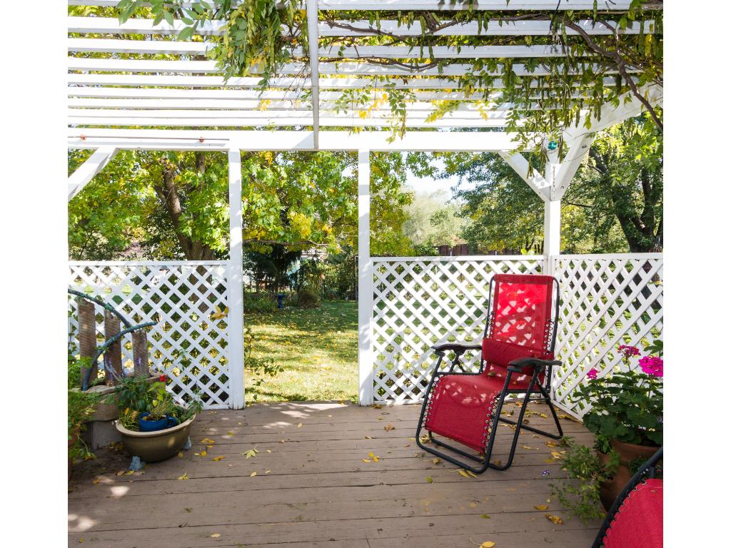 You'll make lasting memories of Summer dinners and morning coffees on your vine-covered deck while appreciating the lush serenity of your pretty gardens and yard.