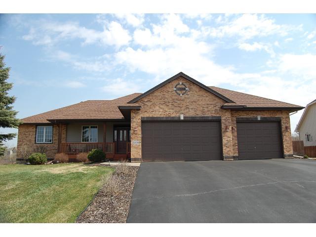 Brick and vinyl exterior offer maintenance free exterior.