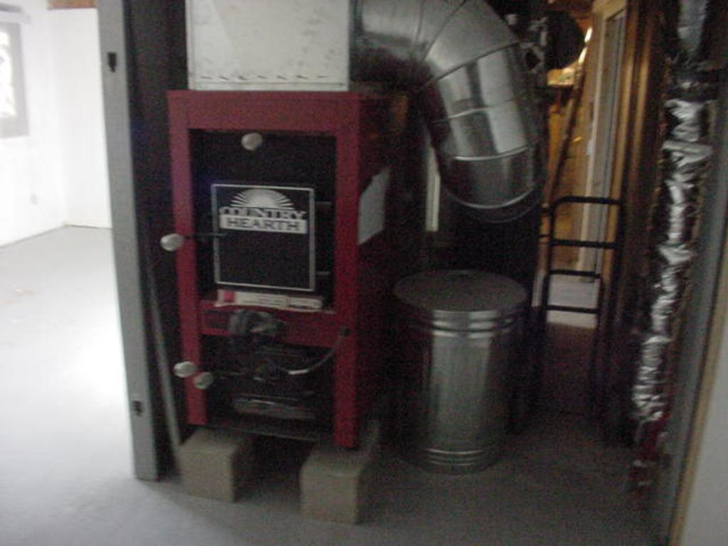 NEW WOOD BURNING FURNACE ALONG WITH NEW PROPANE FORCED AIR FURNACE.