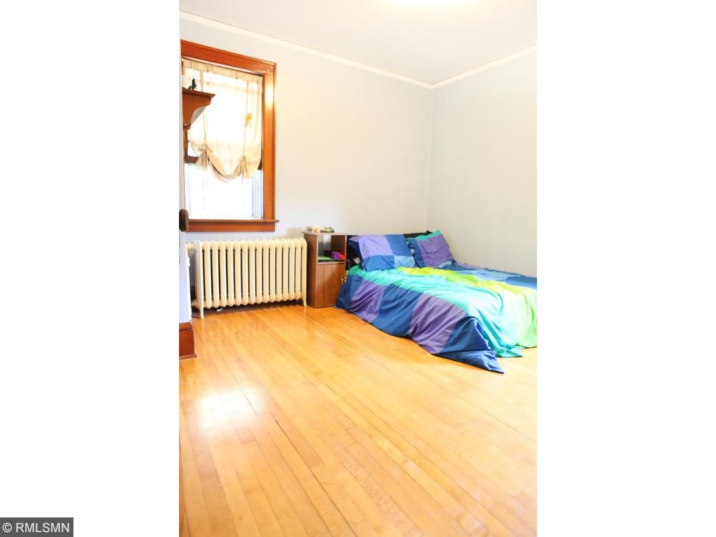This is the second bedroom (main level).  Hardwood floors.