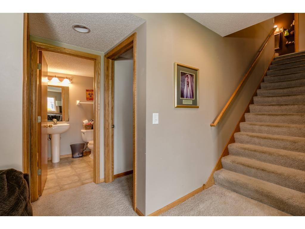 Welcome to the lower level.  Double stacked lookout windows bring in so much natural light you don't feel light you are downstairs!  This level has another large family room, a hobby or exercise room, another bedroom and utility storage area.