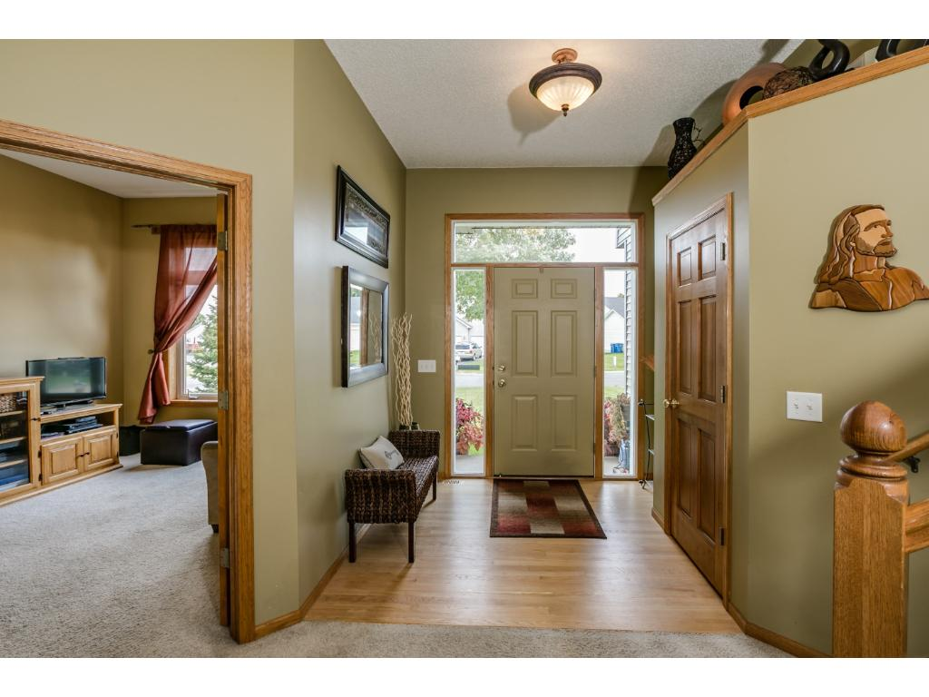 Open concept floor plan with high ceilings in foyer and great room. Updated lighting, oak trim and molding, 6 panel doors and hardwood floors.  Flex room off of foyer has a floor to ceiling stacked window and would be perfect for a main floor office
