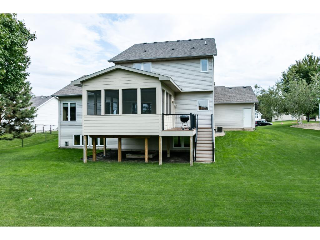 This is a beautiful view of the 3 season porch and deck.  Imagine hanging out and just enjoying the views!  The perfect backyard for animals and children alike!  They can RUN!