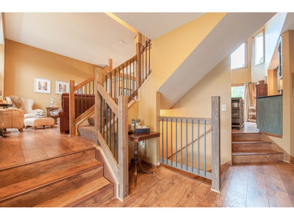 From the entry, step up to the living room on the left and to the kitchen on the right.