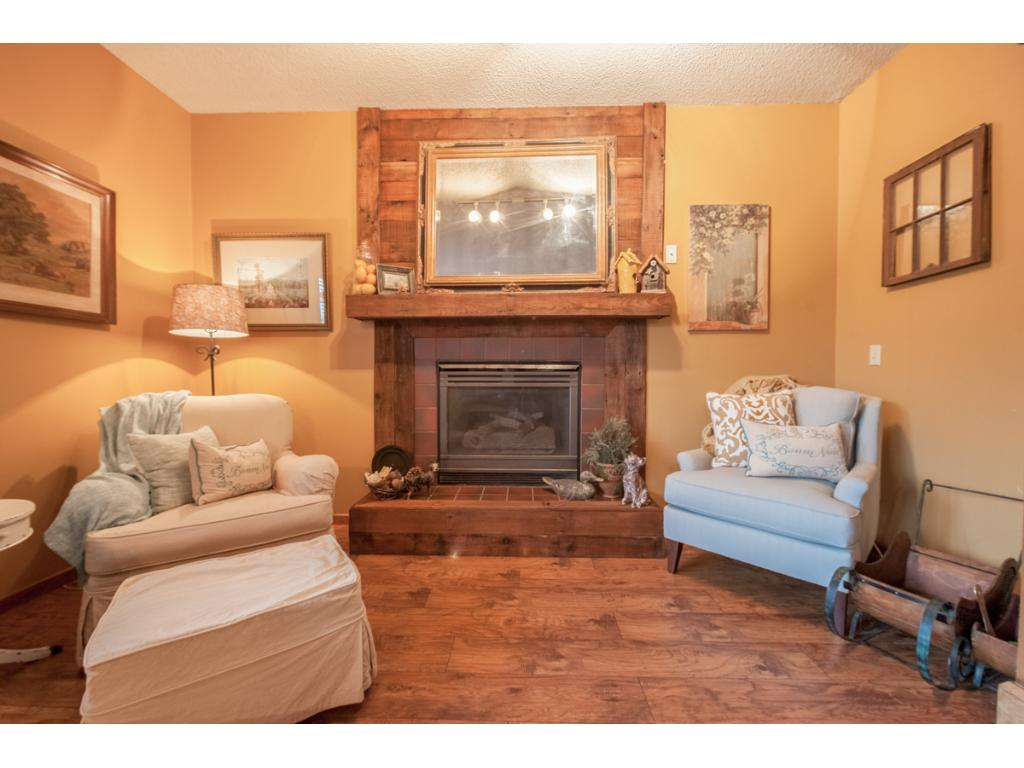 This photo shows a closer look at the unique fireplace with re-claimed barn wood surround and mantel.