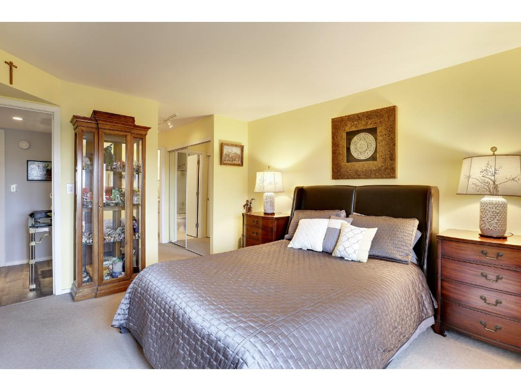View of the master bedroom leading to the private bathroom and double closets.