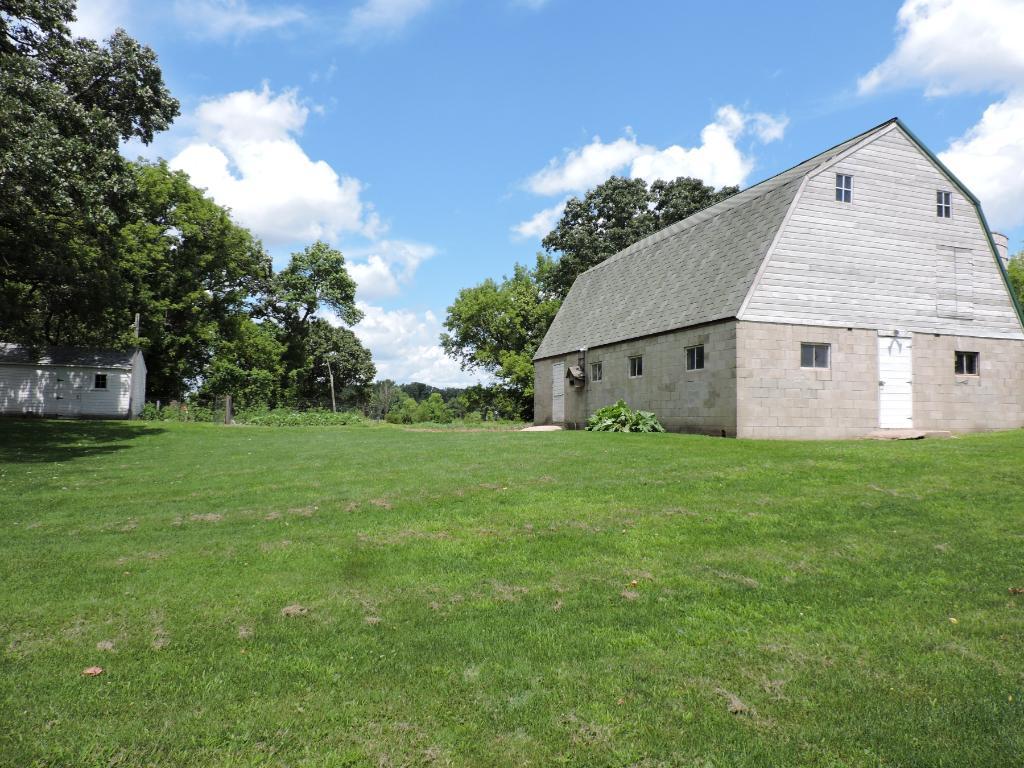 (28X40) Barn w/water and white single garage.