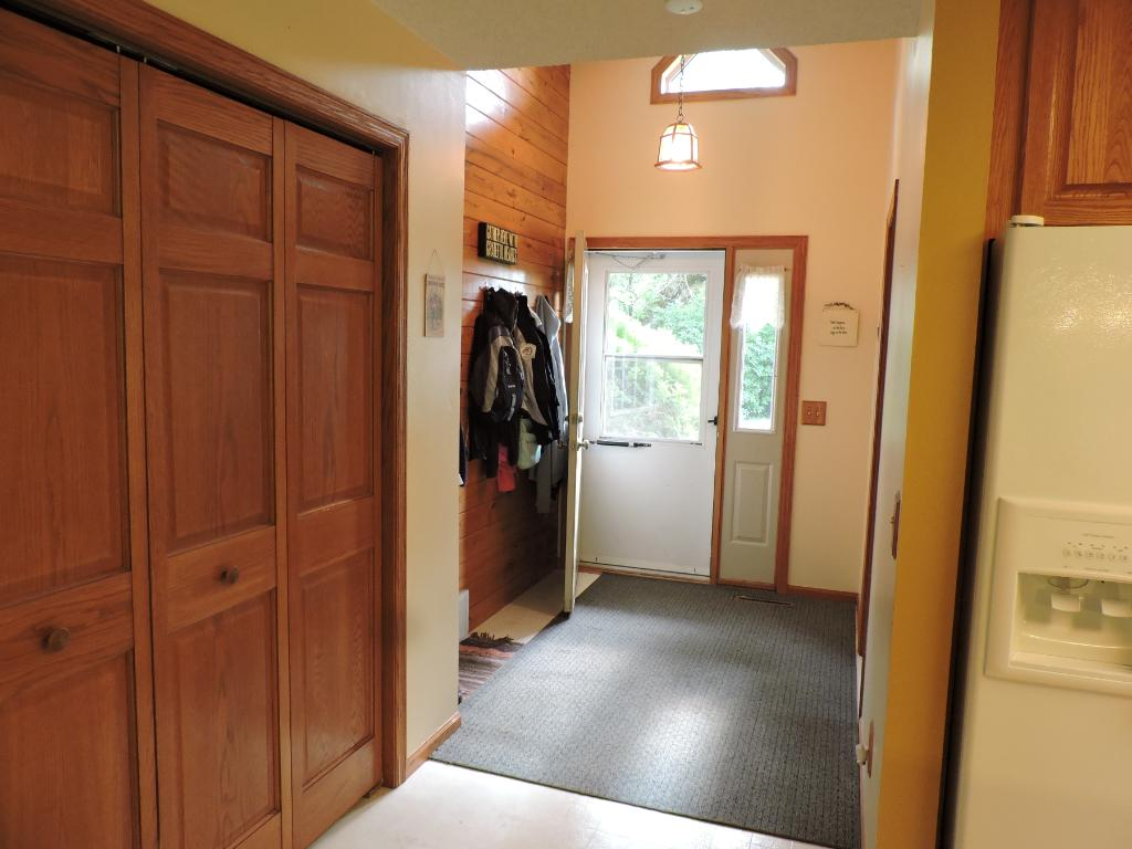 Front entry w/large closet and adjacent 3/4 bathroom and laundry room.