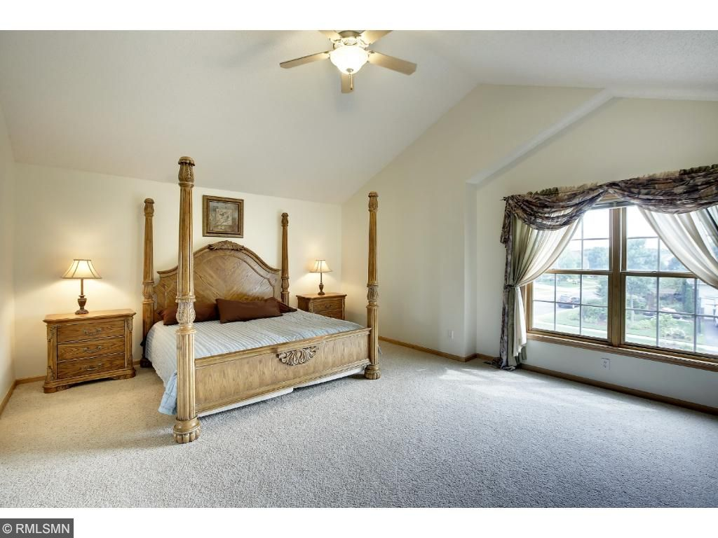 HUGE Master Suite with double doors, vaulted ceiling, private master ensuite bath with jacuzzi tub, separate shower, double vanity sinks and two closets (jack n jill - one is a walk-in).