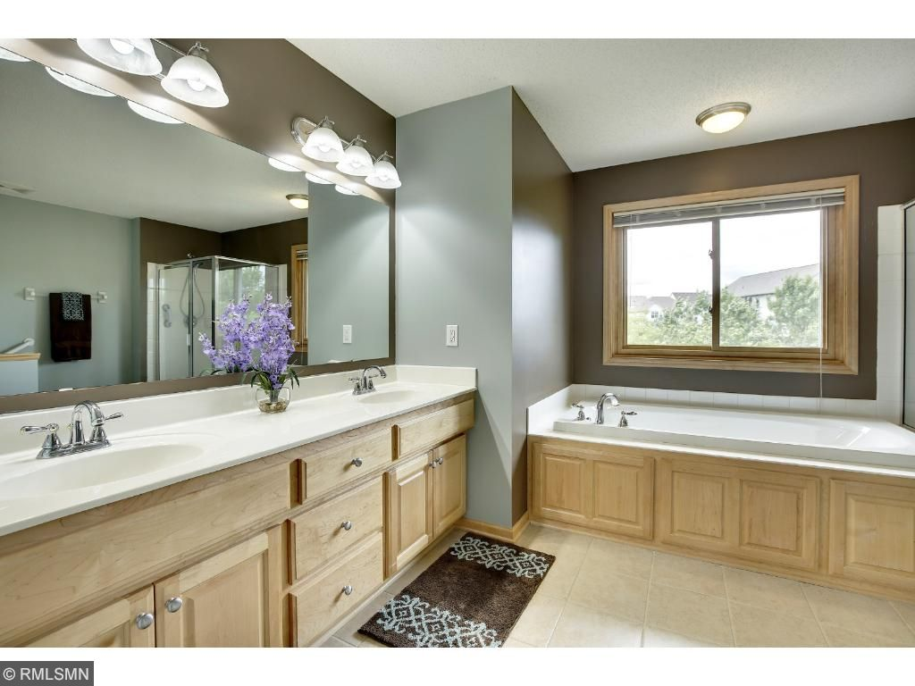 Private master ensuite luxury bath with double vanity sink, jacuzzi tub and separate shower.
