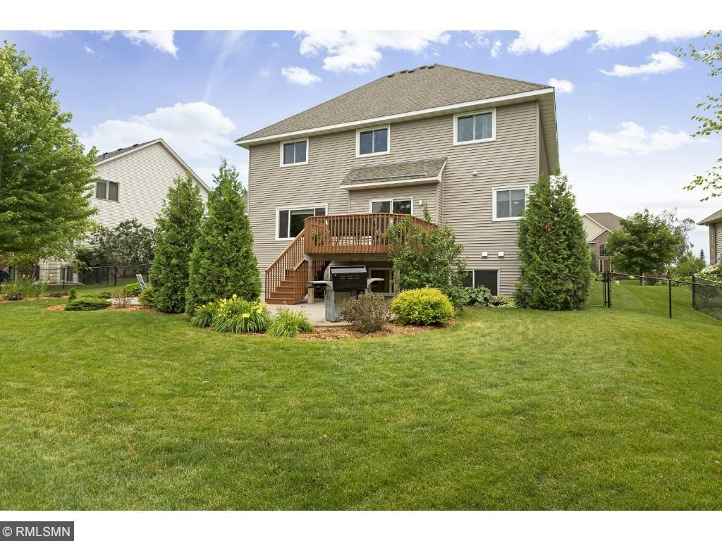Gorgeous setting with fenced backyard.  NEW ROOF (2015), NEW NORTH-SIDE WINDOWS 2016.