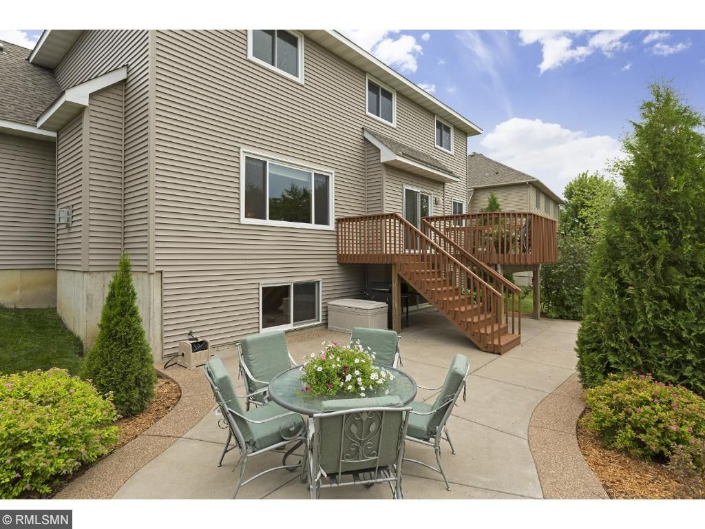 GORGEOUS custom designed patio with spacious deck overlooking beautiful backyard.