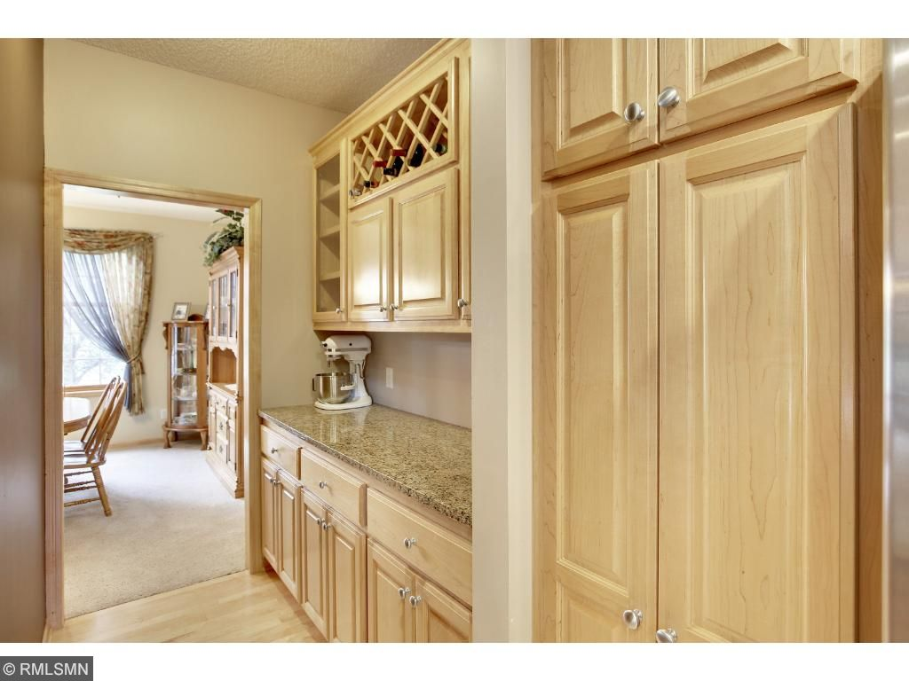 Stunning buffet area with wine rack, granite counter and loads of storage for those linens and extra appliances.