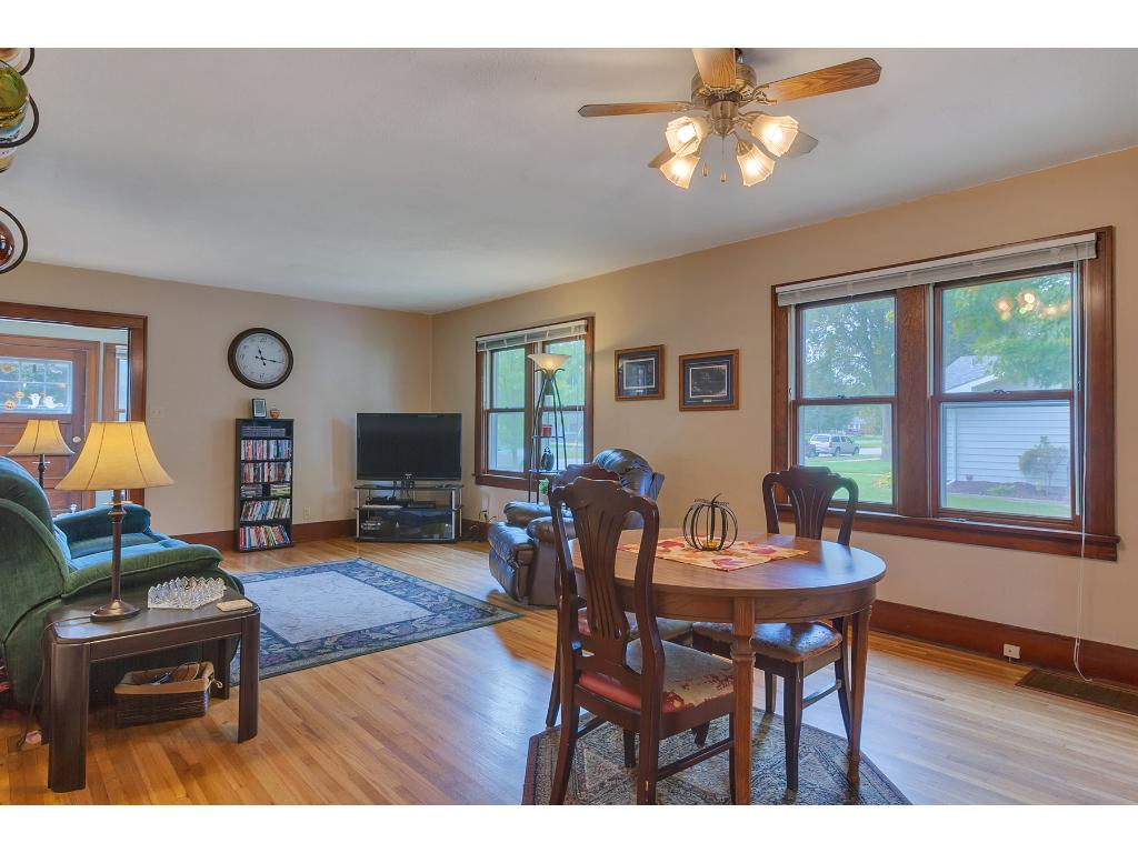 The living room is another large room with large windows and hardwood floors.