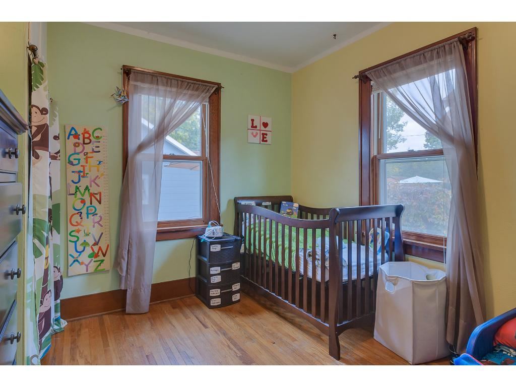 Here's one of the main floor bedrooms which features beautiful hardwood floors.