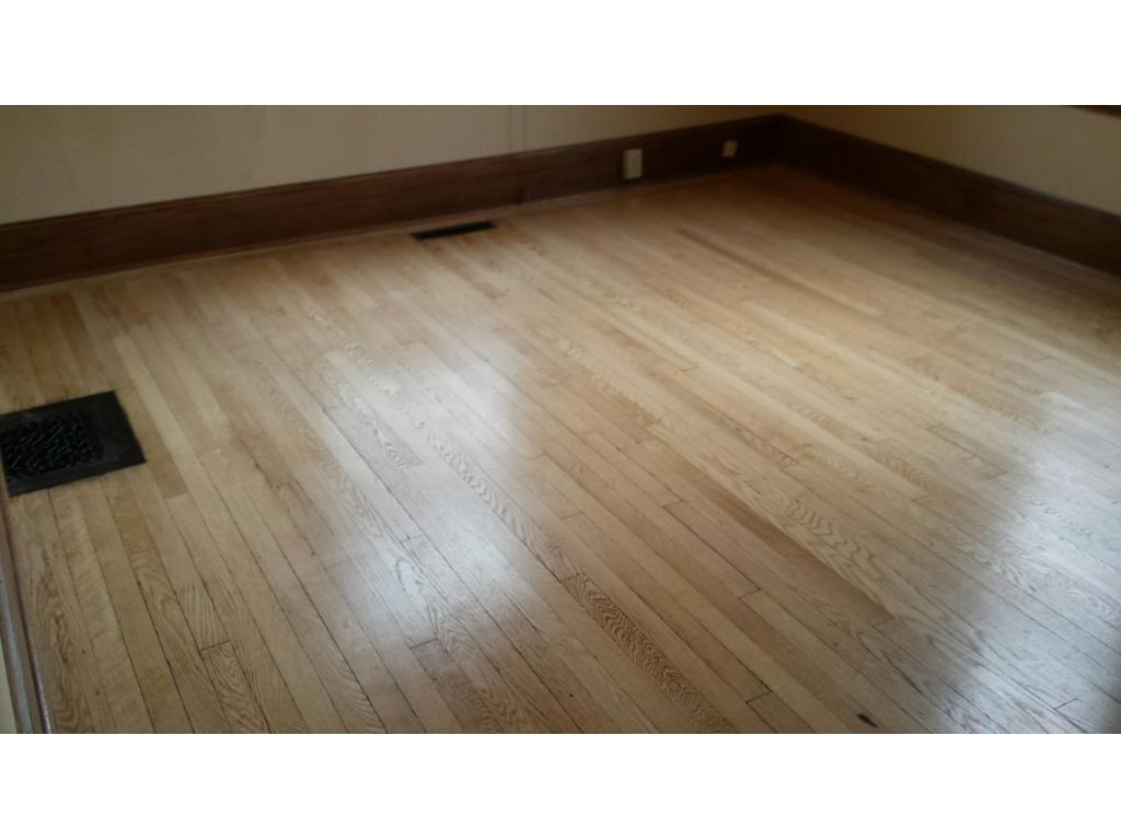 REFINISHED GLEAMING HARDWOOD FLOORS ON 1ST FLOOR OF DUPLEX BEDROOM