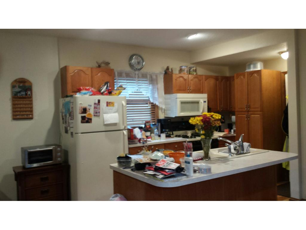 KITCHEN AREA OF SINGLE FAMILY HOME