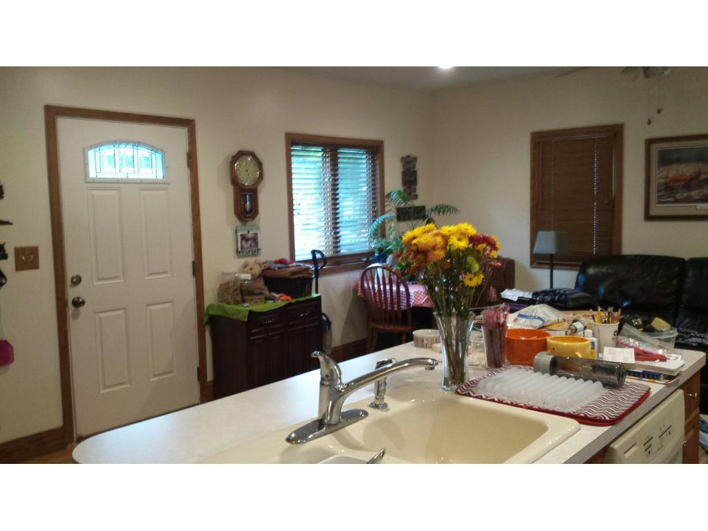 DINING ROOM AND LIVING ROOM OF SINGLE FAMILY HOME