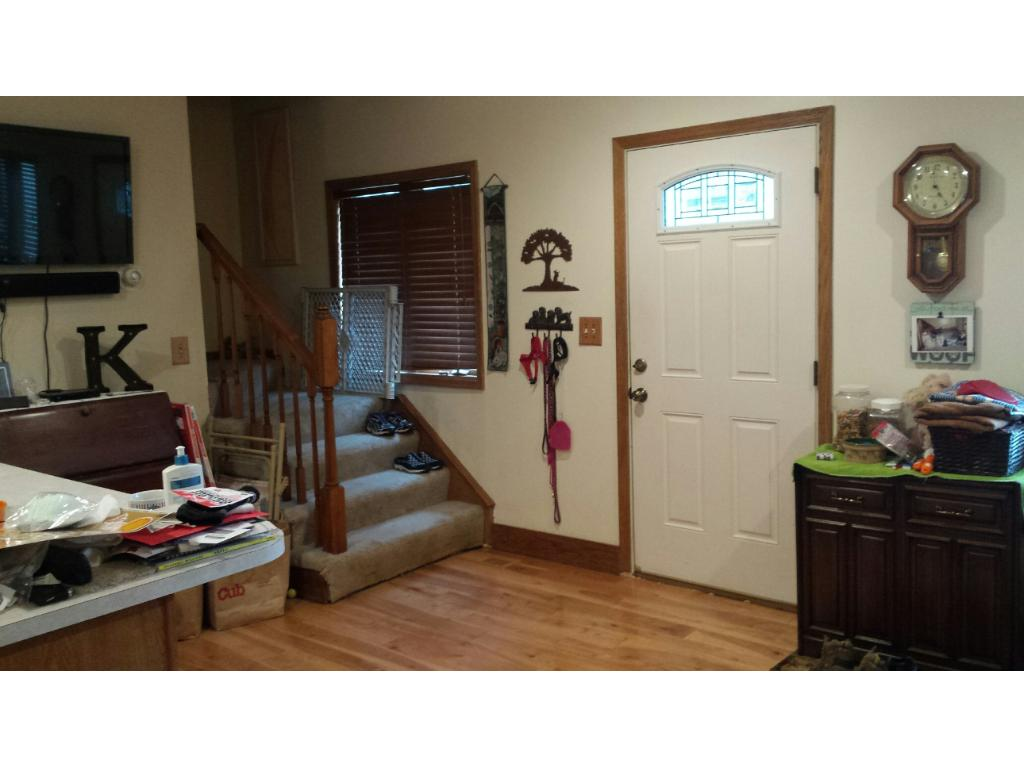 ENTRY INTO LIVING ROOM AND STAIRS TO THE UPPER LEVEL OF SINGLE FAMILY HOME