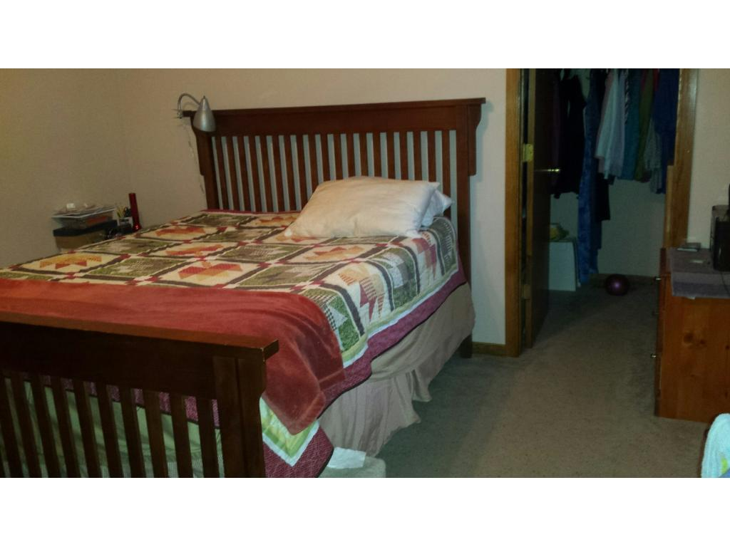 UPPER LEVEL BEDROOM AND WALK-IN CLOSET OF SINGLE FAMILY HOME
