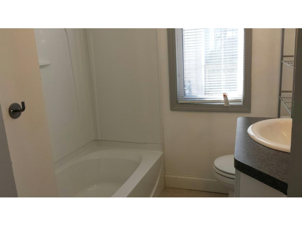 RECENTLY REMODELED FULL BATHROOM ON MAIN LEVEL OF DUPLEX