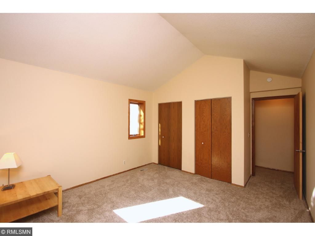 Upper level bedroom features vaulted ceiling
