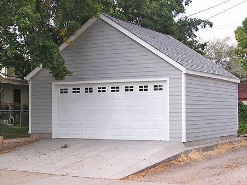 2 car garage currently under construction. Photo  of garage style to be built to match the house.
