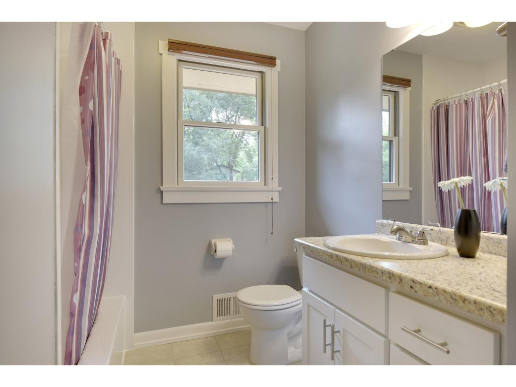 Full bathroom on the main level with tile flooring.