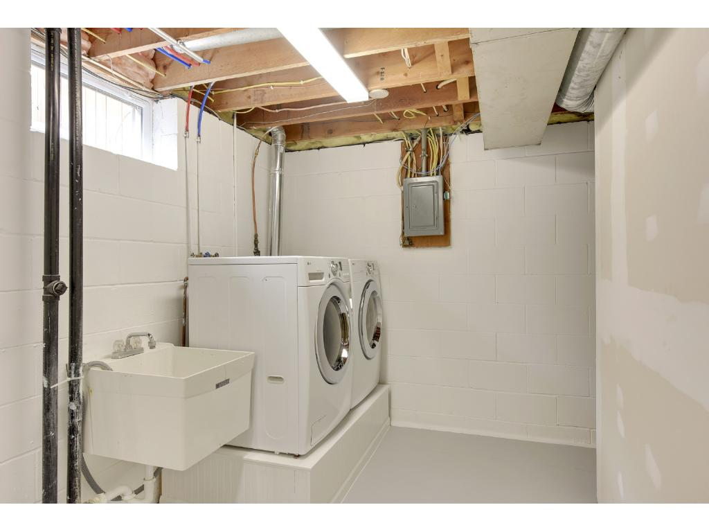 Front loading washer and dryer is included and alot of extra space for storage.