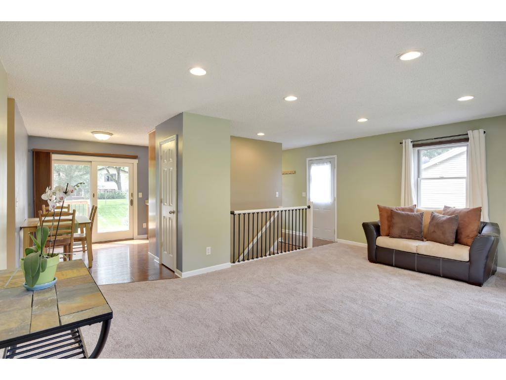 Spacious living room that flows nicely into the eat-in kitchen.  Fresh paint and new carpet throughout the home.