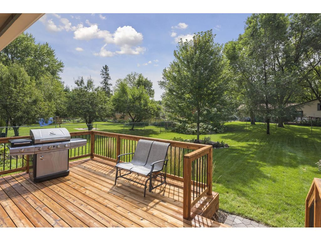 Natural woodwork deck (cedar) leading to amazing green space.