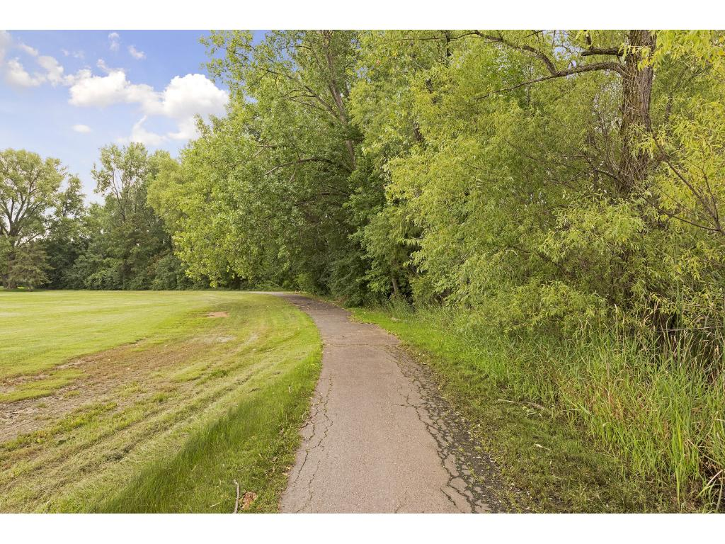 Convenient access to paved trails for morning walks or strolls when you want!  You will love this location!