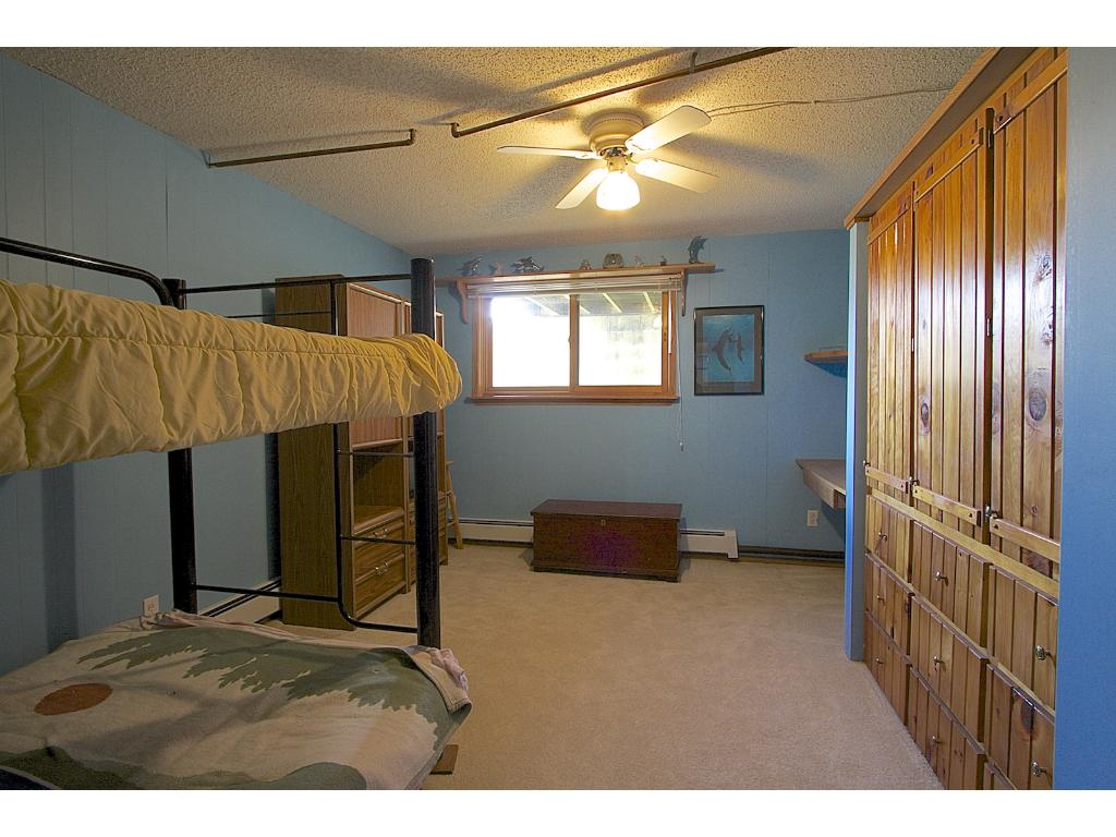 Master bedroom with private bathroom and laundry
