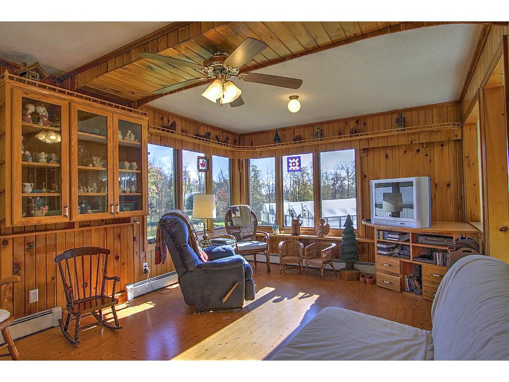 Family room with natural woodwork and more built ins