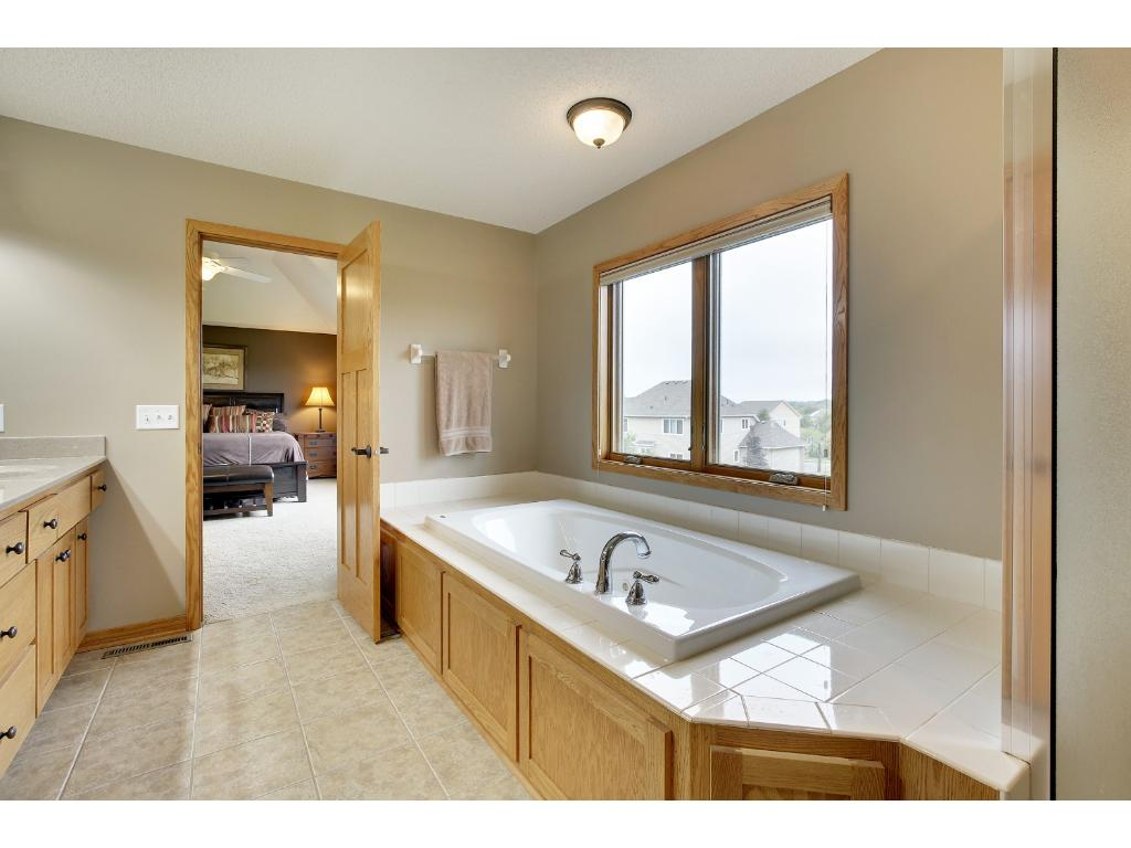 Master Bath with raised vanity, separate jetted tub and shower.